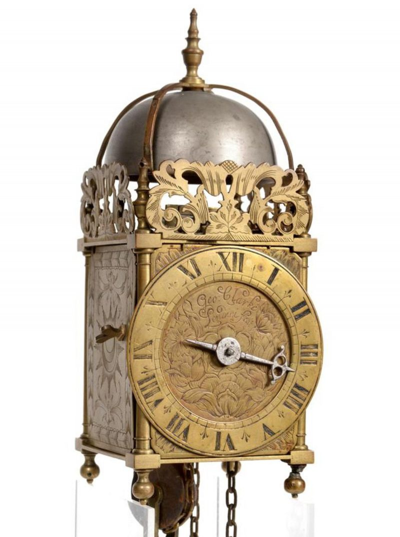 A Small Brass Hook and Spike Lantern Striking Wall Clock, signed Geo Clarke, Londini Fecit, circa 1760 - featured collectibles