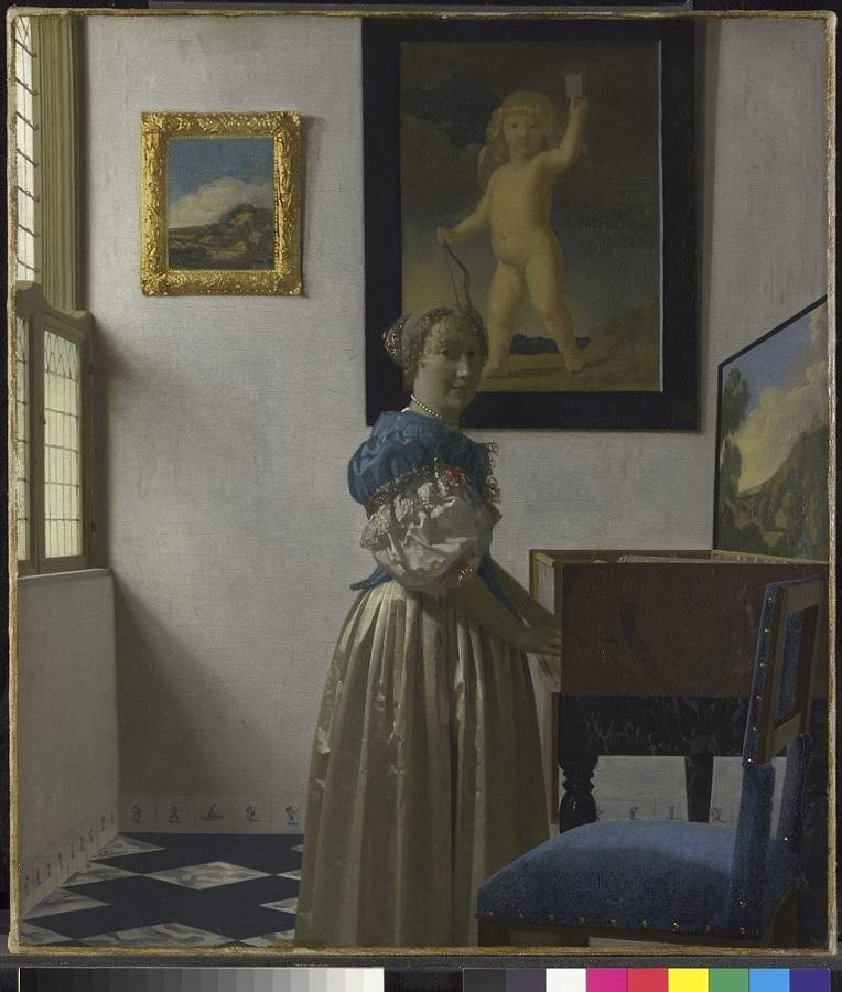 """Jan Vermeer """"Młoda kobieta stojąca przy wirginale"""" (źródło: materiały prasowe)"""